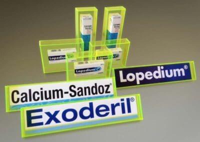 Neonzöld átlátszó plexiből kivágott és ragasztott asztali displayek, amik különböző termékek logóit tartalmazzák, vagy magukat a termékeket mutatják be. A Calcium-Sandoz, Lopedium és az Exoderil számára készültek.